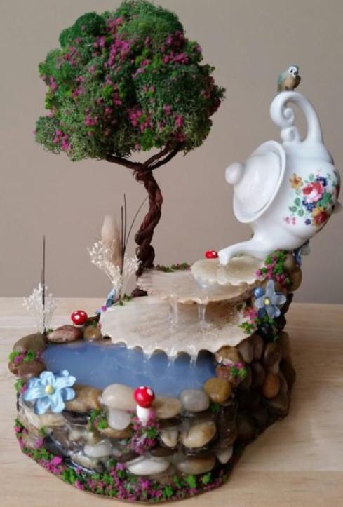 Смастерите красивую композицию на своем участке, используя самые простые вещи...